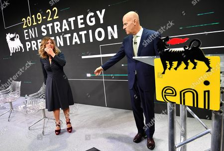 Eni CEO Claudio Descalzi (R) and Eni chairman Emma Marcegaglia pose for photographers prior to the start of the press conference during the 2019-22 ENI strategy presentation in San Donato Milanese, Milan, Italy, 15 March 2019. Eni is an Italian multinational oil and gas company.