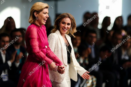 Portuguese designer Sophia Kah (R) appears on the catwalk with Portuguese TV entertainer Raquel Strada after the presentation of her collection during the Portugal Fashion Show in Porto, Portugal, 15 March 2019. Fall-Winter 2019/20 collections are presented at the 44th Portugal Fashion until 17 March.