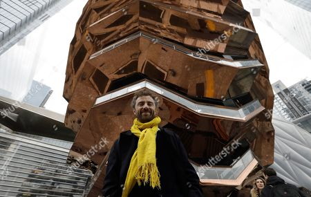 Stock Photo of Thomas Heatherwick, British designer and the founder of London-based design practice Heatherwick Studio, poses in front of his spiral staircase design, the 'Vessel' at the Hudson Yards Grand Opening Ceremony at Hudson Yards in New York, New York, USA, 15 March 2019. Hudson Yards is a real estate development on Manhattan's westside in the neighborhood of Chelsea, which will feature both residential and commercial space along with retail shopping, fine dining, a ten screen movie theater, a public school, and artist exhibition space.