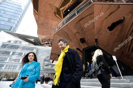 Thomas Heatherwick, (C) British designer and the founder of London-based design practice Heatherwick Studio, exits in front of his spiral staircase design, the 'Vessel' at the Hudson Yards Grand Opening Ceremony at Hudson Yards in New York, New York, USA, 15 March 2019. Hudson Yards is a real estate development on Manhattan's westside in the neighborhood of Chelsea, which will feature both residential and commercial space along with retail shopping, fine dining, a ten screen movie theater, a public school, and artist exhibition space.
