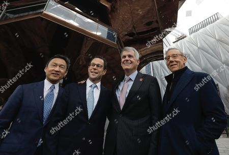 (L-R) Kenneth Wong, COO of Related Companies, Jeff Blau, CEO and partner of Related Companies, Timothy J. Sloan, CEO of Wells Fargo bank and Stephen M. Ross, chairman and founder of Related Companies, pose for photographers at the Hudson Yards Grand Opening Ceremony at Hudson Yards in New York, New York, USA, 15 March 2019. Hudson Yards is a real estate development on Manhattan's westside in the neighborhood of  Chelsea, which will feature both residential and commercial space along with retail shopping, fine dining, a ten screen movie theater, a public school, and artist exhibition space.