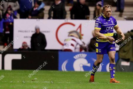 Ben Westwood of Warrington Wolves looks dejected after being sent off
