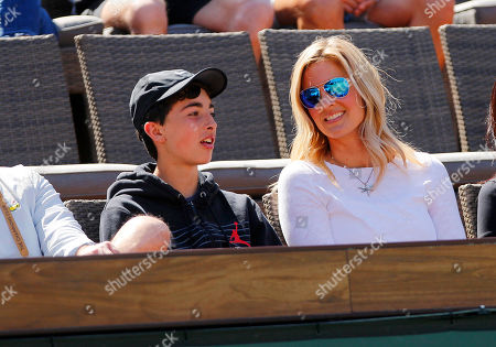 Bridgette Wilson, wife of Pete Sampras, chats with their son