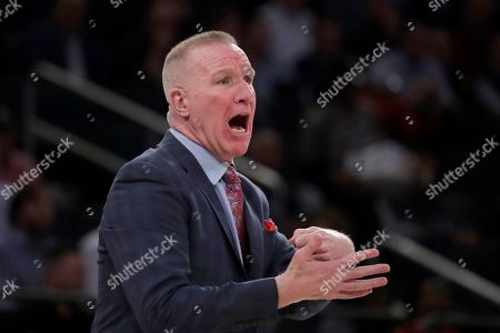 St. John's head coach Chris Mullin reacts during the first half of an NCAA college basketball game against Marquette in the Big East men's tournament, in New York