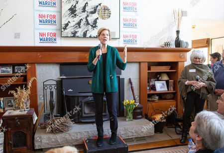 Stock Photo of Democratic candidate for United States President Elizabeth Warren addresses a group of voters at the home of Jim and Liz Smith, during a campaign stop in Salem, New Hampshire, USA, 15 March 2019.