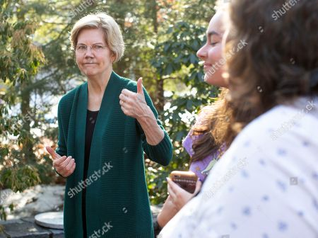 Democratic candidate for United States President Elizabeth Warren gestures to a supporter at the home of Jim and Liz Smith, where Warren addressed a group of voters during a campaign stop in Salem, New Hampshire, USA, 15 March 2019.