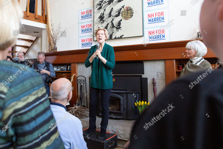 Stock Picture of Democratic candidate for United States President Elizabeth Warren addresses a group of voters at the home of Jim and Liz Smith, during a campaign stop in Salem, New Hampshire, USA, 15 March 2019.