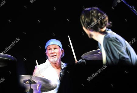 Drummer Chad Smith (L) of US rock band Red Hot Chili Peppers performs during their concert in front of the Great Pyramids in Giza, Egypt, 15 March 2019.