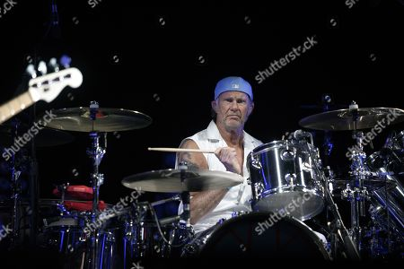 Drummer Chad Smith of US rock band Red Hot Chili Peppers performs during their concert in front of the Great Pyramids in Giza, Egypt, 15 March 2019.
