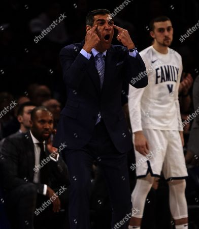 Stock Picture of New York, New York, U.S. - Villanova Wildcats head coach Jay Wright during the semifinal round of the Big East Tournament between the Xavier Musketeers and the Villanova Wildcats at Madison Square Garden in New York City. Villanova defeated Xavier in overtime 71-67