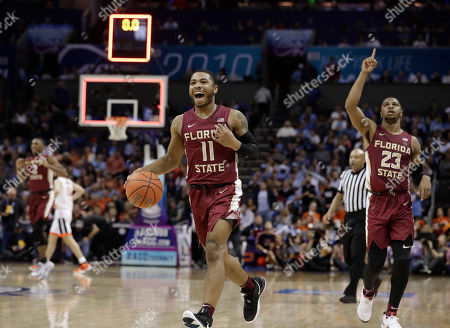Florida State's David Nichols (11) and M.J. Walker (23) react after their team defeated Virginia in an NCAA college basketball game in the Atlantic Coast Conference tournament in Charlotte, N.C