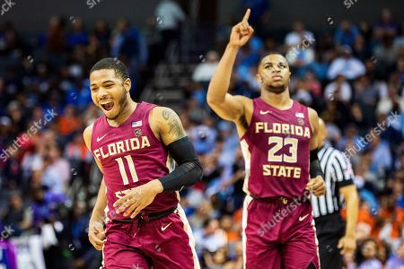 Stock Picture of Florida State Seminoles guard David Nichols (11) and Florida State Seminoles guard M.J. Walker (23) during the ACC College Basketball Tournament game between the Florida State Seminoles and the Virginia Cavaliers at the Spectrum Center on in Charlotte, NC