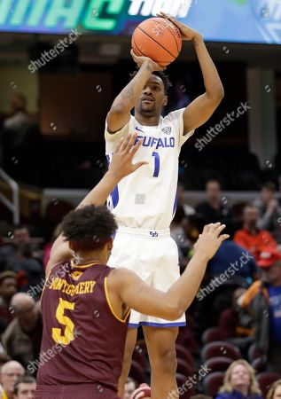 Buffalo's Montell McRae(1) shoots over Central Michigan's Robert Montgomery (5) during the first half of an NCAA college basketball game in the semifinals of the Mid-American Conference men's tournament, in Cleveland
