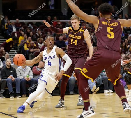 Buffalo's Davonta Jordan (4) drives past Central Michigan's David DiLeo (14) and Robert Montgomery during the first half of an NCAA college basketball game in the semifinals of the Mid-American Conference men's tournament, in Cleveland