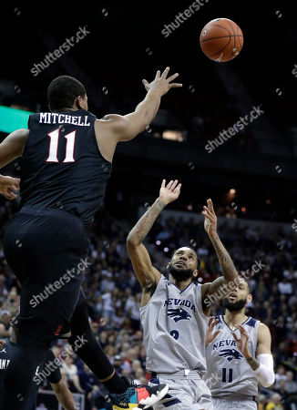 San Diego State's Matt Mitchell (11) defends as Nevada's Corey Henson shoots during the first half of an NCAA college basketball game in the Mountain West Conference men's tournament, in Las Vegas