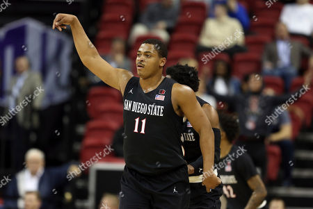 San Diego State's Matt Mitchell reacts after sinking a 3-point shot during the first half of the team's NCAA college basketball game against Nevada in the Mountain West Conference men's tournament, in Las Vegas