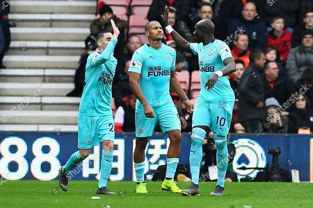 Miguel Almiron of Newcastle United left and Mohamed Diame of Newcastle United right celebrate the first goal scored by Jose Salomon Rondon of Newcastle United middle during AFC Bournemouth vs Newcastle United, Premier League Football at the Vitality Stadium on 16th March 2019