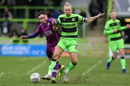 Forest Green Rovers Joseph Mills(23) and Carlisle United's Nathan Thomas(16) during the EFL Sky Bet League 2 match between Forest Green Rovers and Carlisle United at the New Lawn, Forest Green