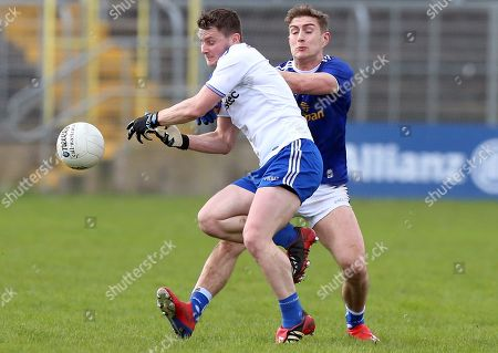 Stock Image of Monaghan vs Cavan. Monaghan's Dermot Malone with Cavan's Killian Clarke