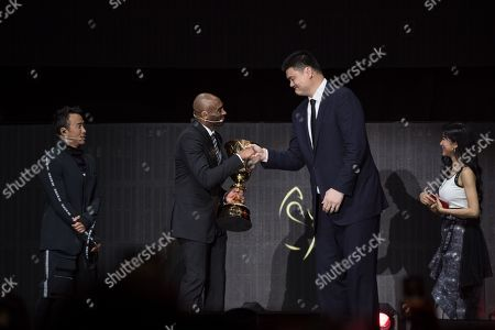 World Cup ambassadors Yao Ming, (2R), and Kobe Bryant, (2L), shake hands as they pass the trophy during the FIBA Basketball World Cup 2019 Draw in Shenzhen, Guangdong Province, China, 16 March 2019. FIBA Basketball World Cup 2019 will take place in China from 31 Aug. to 15 Sept. 2019.