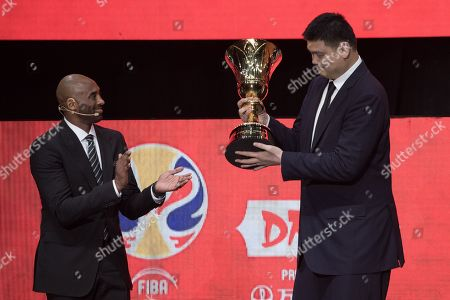 Stock Photo of World Cup ambassadors Yao Ming, (C), and Kobe Bryant, (L), pass the trophy during the FIBA Basketball World Cup 2019 Draw in Shenzhen, Guangdong Province, China, 16 March 2019. FIBA Basketball World Cup 2019 will take place in China from 31 Aug. to 15 Sept. 2019.