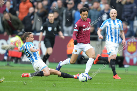 Chris Lowe of Huddersfield Town slides in on Felipe Anderson during West Ham United vs Huddersfield Town, Premier League Football at The London Stadium on 16th March 2019