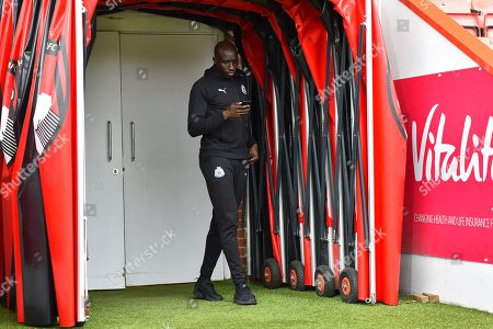 Mohamed Diame (10) of Newcastle United in the tunnel with his phone on arrival before the Premier League match between Bournemouth and Newcastle United at the Vitality Stadium, Bournemouth