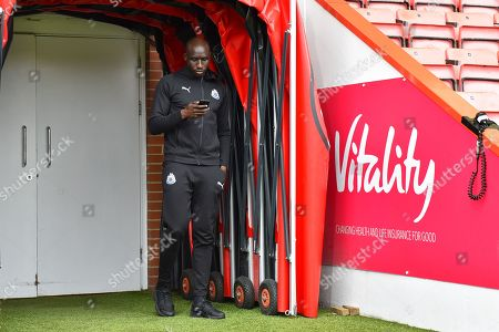 Mohamed Diame (10) of Newcastle United in the tunnel checking his phone on arrival before the Premier League match between Bournemouth and Newcastle United at the Vitality Stadium, Bournemouth