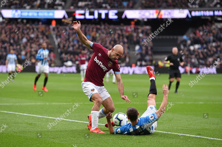 Pablo Zabaleta of West Ham United gets tangled up with Chris Lowe of Huddersfield Town