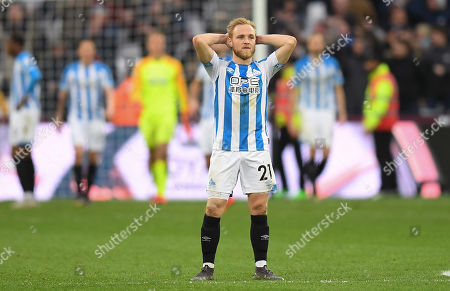 Alex Pritchard of Huddersfield Town looks dejected after the goal by Javier Hernandez of West Ham United, 4-3