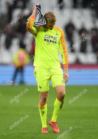 Huddersfield Town Goalkeeper Jonas Lossl looks dejected at full-time