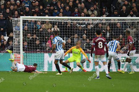 Huddersfield Town Goalkeeper Jonas Lossl looks on as the headed shot by Javier Hernandez of West Ham United goes in, 3-3
