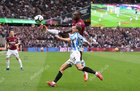 Michail Antonio of West Ham United and Chris Lowe of Huddersfield Town