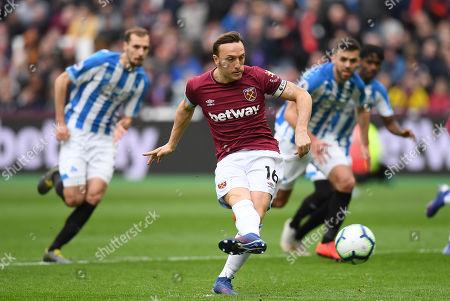 Mark Noble of West Ham United scores a goal past Huddersfield Town Goalkeeper Jonas Lossl, 1-0