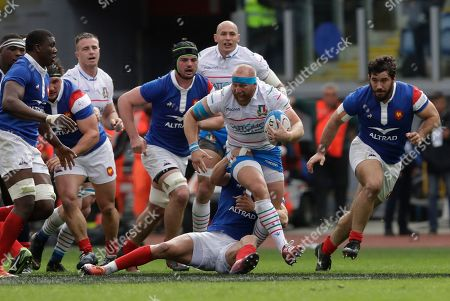 Italy's Leonardo Ghiraldini runs with the ball during the Six Nations rugby union international match between Italy and France, at the Rome Olympic stadium