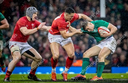 Wales vs Ireland. Wales' Owen Watkin and Jonathan Davies with Jordan Larmour of Ireland
