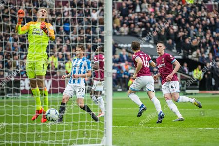 Mark Noble (Capt)(West Ham) celebrates his goal with Declan Rice (West Ham) while Jonas Lossl (GK) (Huddersfield) expresses his frustration within the goal mouth during the Premier League match between West Ham United and Huddersfield Town at the London Stadium, London
