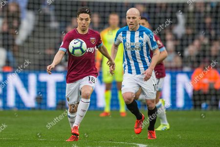 Samir Nasri (West Ham) & Aaron Mooy (Huddersfield) during the Premier League match between West Ham United and Huddersfield Town at the London Stadium, London