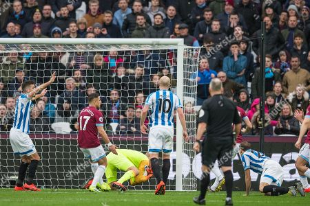Jonas Lossl (GK) (Huddersfield) saves the ball during the Premier League match between West Ham United and Huddersfield Town at the London Stadium, London
