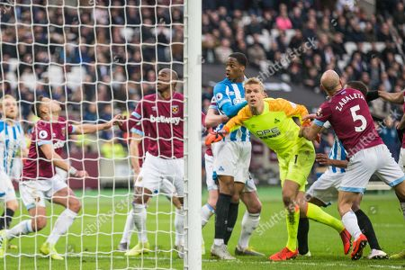 Jonas Lossl (GK) (Huddersfield) joining team mates attempting to score a last minute goal during the Premier League match between West Ham United and Huddersfield Town at the London Stadium, London