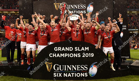 Alun Wyn Jones of Wales lifts the Six Nations trophy as Jonathan Davies of Wales lifts the triple crown.