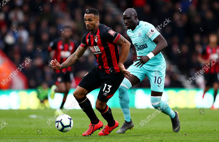 Callum Wilson of Bournemouth and Mohamed Diame of Newcastle United.