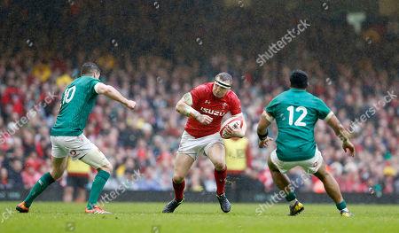 Hadleigh Parkes of Wales runs at Jonny Sexton (left) and Bundee Aki (12) of Ireland