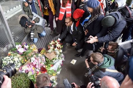 The marchers stop to lay flowers outside the New Zealand High Commission. (Claudia Webbe right). Protesters marching through London in the UN Anti Racism Day demonstration.
