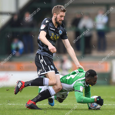 Tom James of Yeovil Town is fouled by James Pearson of Macclesfield Town