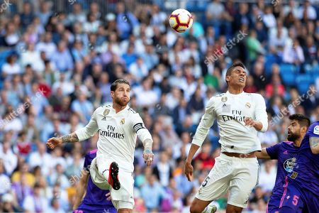 Real Madrid's Sergio Ramos (L) and Raphael Varane (R) in action during the Spanish La Liga soccer match between Real Madrid and Celta Vigo at the Santiago Bernabeu stadium in Madrid, Spain, 16 March 2019.