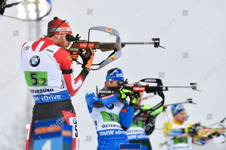 Simon Eder (L) of Austria takes aim at the shooting range during the men's 4x7,5km Relay race at the IBU Biathlon World Championships in Oestersund, Sweden, 16 March 2019.