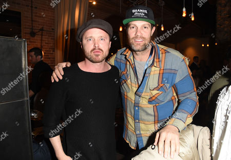 Aaron Paul and Geoffrey Stults attend the 2019 Sun Valley Film Festival Pioneer Dinner presented by Variety, held at the Enoteca in Sun Valley, ID
