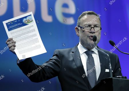 Michael Schneider, the President of the EPP Group in the European Committee of the Regions, flashes the EPP Regional and Local Manifesto while delivering a speech at the EPP-CoR Summit, in Bucharest, Romania, 16 March 2019. Up to 150 mayors and regional leaders from Europe, as well as about three thousand local elected representatives from Romania, participate at the EPP Summit, held at Romexpo Exhibition Centre. At the EPP Bucharest Summit, Manfred Weber presented the EPP programme for the European Commission presidency. European Union parliamentary elections will take place for 23 till 26 of May 2019.