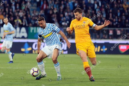 Spal's Thiago Cionek  (L) and Roma's  Edin Dzeko  (R) in action during the Italian Serie A soccer match S.P.A.L. vs AS Roma at Paolo Mazza Stadium in Ferrara, Italy, 16 March 2019.